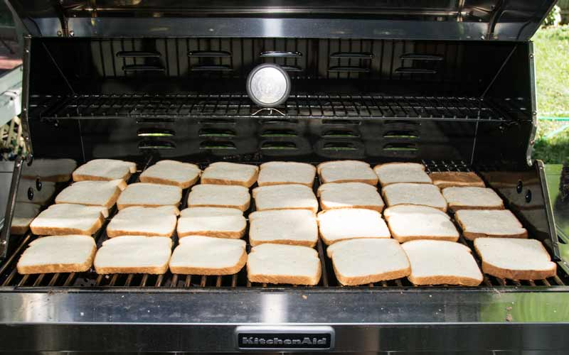 It's as simple as covering your grill in cheap white bread